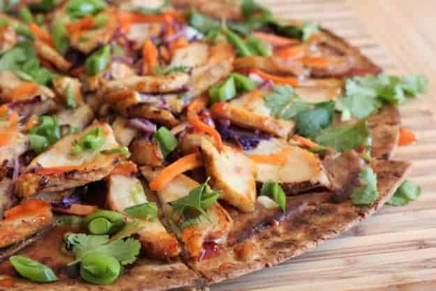 Thai Grilled Chicken Pizza | homemade pizza recipes, pizza recipe ideas, how to make a homemade pizza, thai inspired recipes, recipes using chicken, chicken pizza recipes, easy pizza recipes, family friendly recipes || The Butter Half via @thebutterhalf