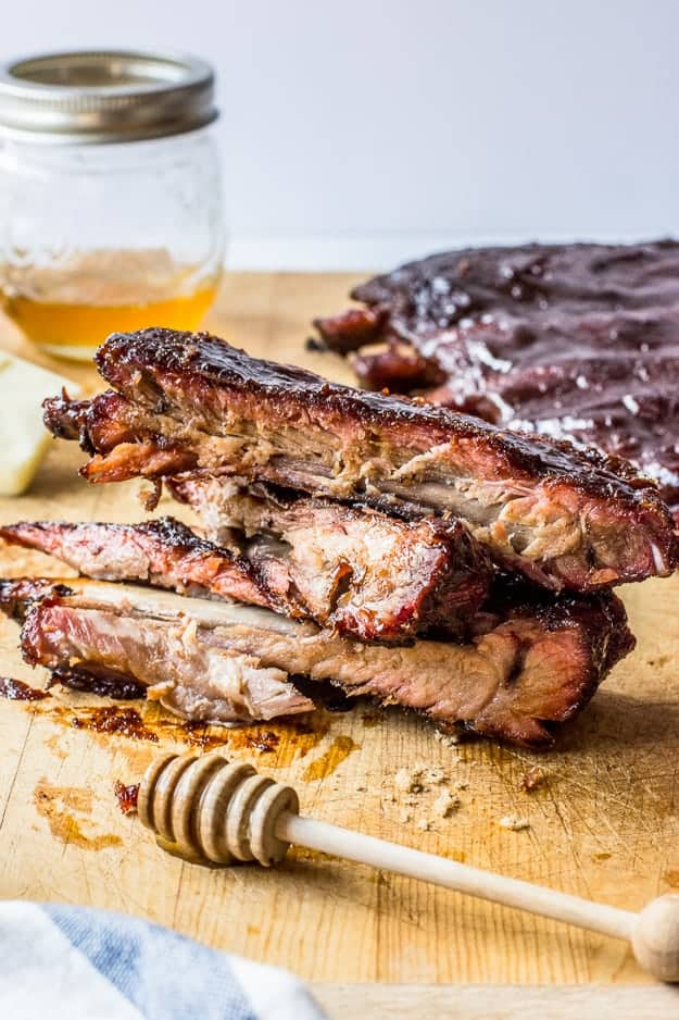 How to Make Smoked Ribs with Honey Butter Brown Sugar | smoking ribs, how to use a smoker, pork ribs, good grilling recipes, rib rub recipes, smoked ribs recipe, summer recipes, grilling ideas, how to make homemade ribs, homemade rib recipe, homemade grilling recipes, how to smoke ribs || The Butter Half via @thebutterhalf