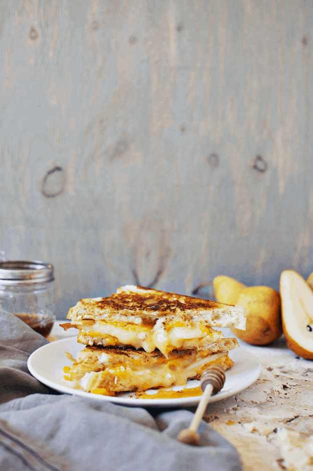 Brie And Cheddar Grilled Cheese With Honey Glazed Pears | grilled cheese recipes, glazed pear recipe, grilled cheese sandwich, gourmet grilled cheese, easy lunch recipes || The Butter Half via @thebutterhalf #grilledcheese #glazedpears #easylunch