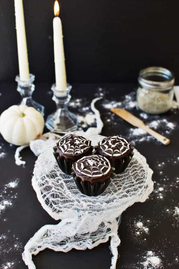 How to Make Spiderweb Cupcakes | halloween dessert recipes, halloween cupcake recipes, halloween treat ideas, homemade halloween treats, cupcake recipes for halloween, spiderweb dessert recipes || The Butter Half via @thebutterhalf