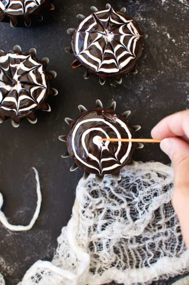 How to Make Spiderweb Cupcakes | halloween dessert recipes, halloween cupcake recipes, halloween treat ideas, homemade halloween treats, cupcake recipes for halloween, spiderweb dessert recipes || The Butter Half #spiderwebcupcakes #halloweencupcakes #halloweentreats #thebutterhalf