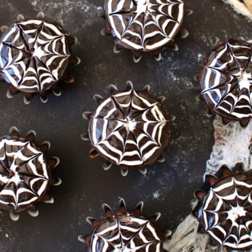 How to Make Spiderweb Cupcakes | halloween dessert recipes, halloween cupcake recipes, halloween treat ideas, homemade halloween treats, cupcake recipes for halloween, spiderweb dessert recipes || The Butter Half via @thebutterhalf
