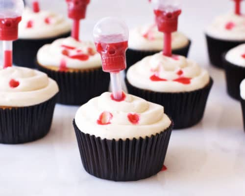 Vampire Bite Cupcakes with Edible Blood | easy halloween recipes, halloween dessert recipes, halloween treat recipes, halloween cupcake recipes, fun halloween recipes, vampire recipe ideas, spooky halloween treats, kid-friendly halloween treats, homemade halloween recipes || The Butter Half via @thebutterhalf