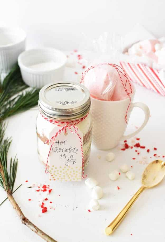 Bring good tidings of comfort and jar to your friends and neighbors this year with this Homemade Hot Chocolate In A Jar! With only 5 ingredients, it's easy to assemble and the perfect gift for a teacher! || The Butter Half #hotchocolate #homemadegifts #teachergifts #giftsinajar #thebutterhalf