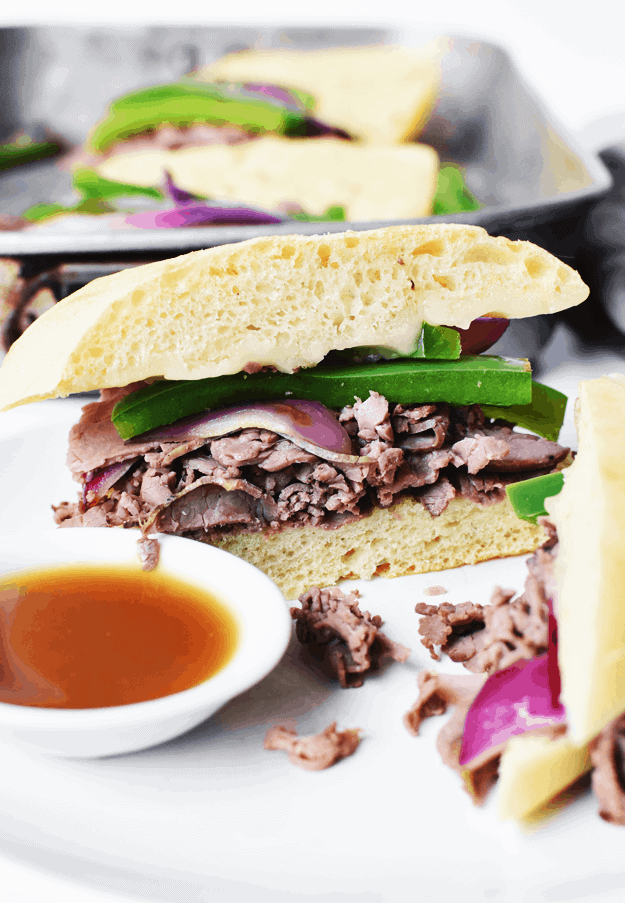 15-Minute Roast Beef Dip Sandwiches with Purple Sweet Potato Fries | beef recipe ideas, quick dinner recipes, easy sandwich recipes, homemade beef dip recipe, easy dinner recipes, purple potato recipes, how to cook purple potatoes || The Butter Half via @thebutterhalf #roastbeef #sandwichrecipes #easydinner #purplepotatoes