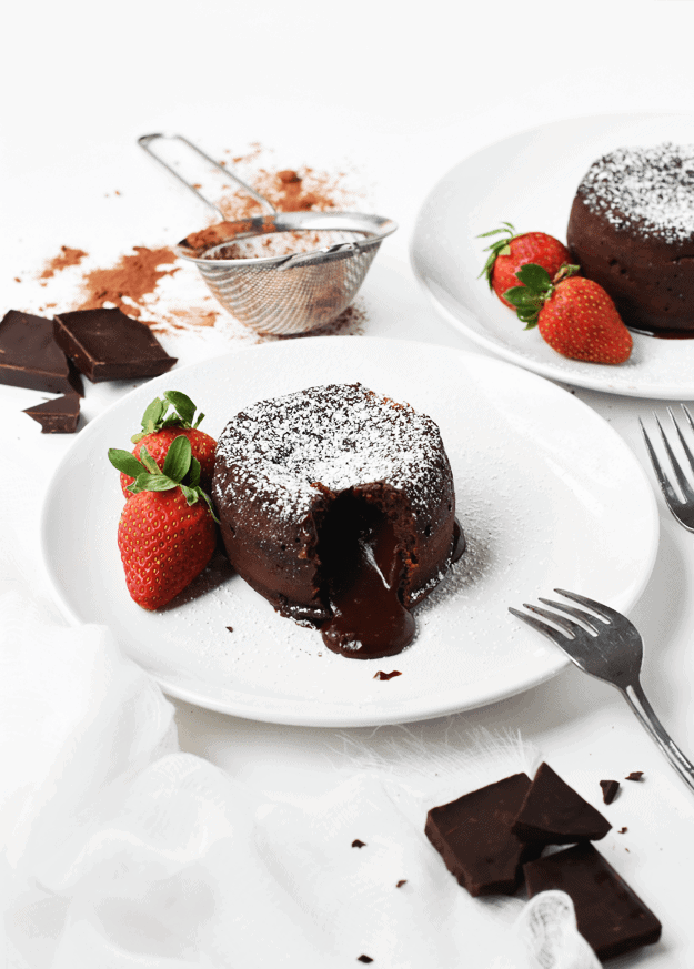 Chocolate cake with gooey middle and strawberries