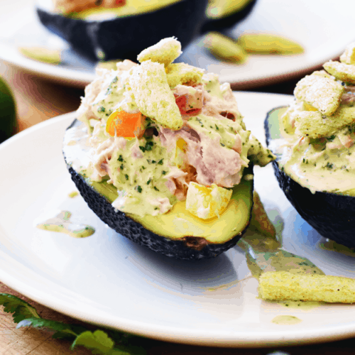 Close up of avocado stuffed with tuna and peppers and cilantro lime dressing