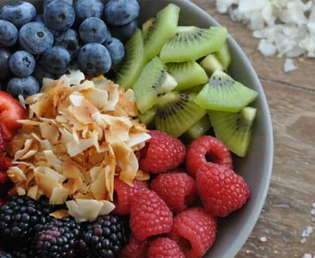 Salted Coconut Over Fruit | easy coconut recipes | healthy breakfast recipes | salted coconut recipe | dried coconut recipe || The Butter Half via @thebutterhalf #saltedcoconut #driedcoconut #fruitbowl