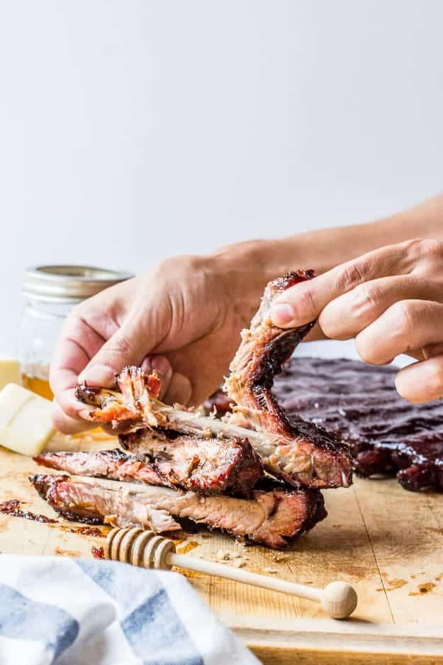 How to Make Smoked Ribs with Honey Butter Brown Sugar | smoking ribs, how to use a smoker, pork ribs, good grilling recipes, rib rub recipes, smoked ribs recipe, summer recipes, grilling ideas, how to make homemade ribs, homemade rib recipe, homemade grilling recipes, how to smoke ribs #smokedribrecipes #ribrub #grilledribsrecipe || The Butter Half via @thebutterhalf