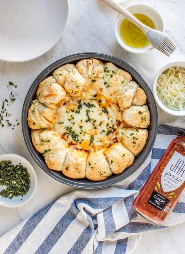 Cheesy Baked Pizza Dip Appetizer | pizza appetizer recipes, easy appetizers, homemade appetizer recipes, pizza inspired recipes, appetizer recipes, bread appetizers, homemade pizza dip, pizza dip recipe || The Butter Half via @thebutterhalf #appetizer #pizzabread #pizzaappetizer #easyappetizer