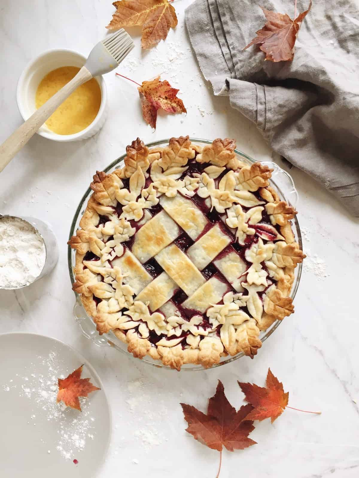 How to Make a Lattice Pie Crust Video + Decorative Leaf Pie Crust | homemade pie crust, pie crust tutorial, lattice pie crust tutorial, decorative pie crust tutorial, how to make a homemade pie crust || The Butter Half via @thebutterhalf #piecrust #pietutorial #homemadepie #bakingtips