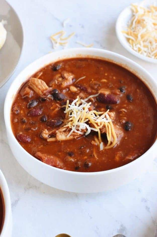 Sweet and Easy Instant Pot Chili with Chicken and Beans | instant pot soup recipes, pressure cooker soup recipes, instant pot chili, pressure cooker chili, easy dinner recipes, easy chili recipes, chicken chili recipes, homemade chili recipes || The Butter Half via @thebutterhalf #instantpot #chilirecipes #easydinner #pressurecooker