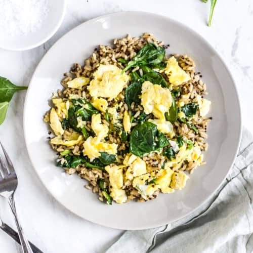 Healthy Brown Rice Breakfast Bowl with Eggs and Spinach