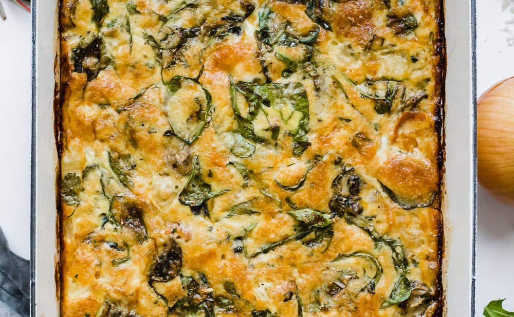 overhead shot of baked frittata in white cast iron 9x13 pan
